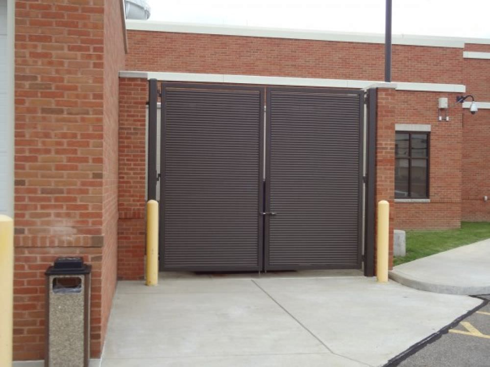 DOUBLE SWING GATES SHADOW 100 GALVANIZED STEEL FIXED LOUVER GALVANIZED AND POWDER COATED AT THE STRONGSVILLE POLICE DEPARTMENT 445