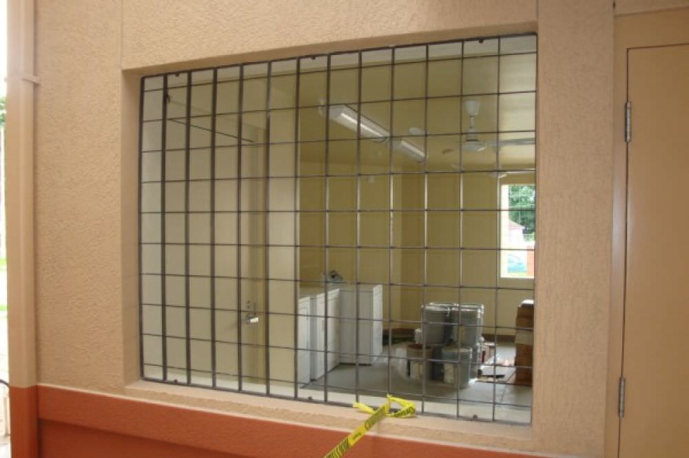 Window guards ametco manufacturing for Metal window designs